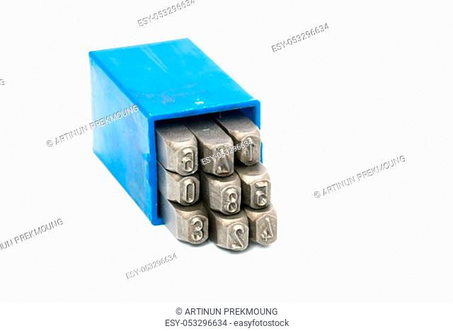 Set of metal stamp number punch in blue plastic box isolated on white background