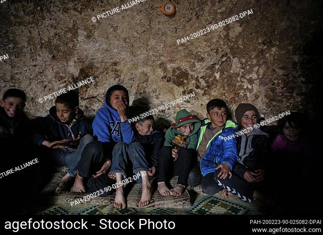 23 February 2020, Syria, Idlib: Syrian children pictured inside a cave at Taltouna village. At least eight families live in an ancient deserted cave after being...