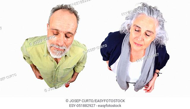 couple with closed eyes on white
