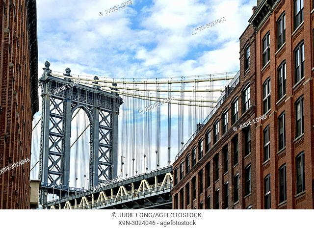 Brooklyn, NY, USA, DUMBO. Looking up at the East Manhattan Bridge Tower from the DUMBO Section of Brooklyn