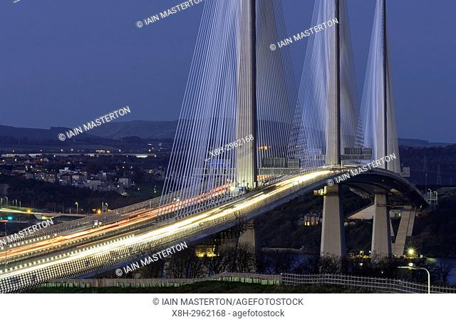 View of new Queensferry Crossing bridge at night spanning the Firth of Forth between West Lothian and Fife in Scotland, United Kingdom