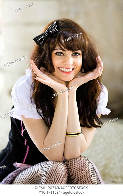 Attractive French maid is smiling