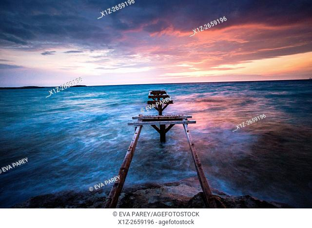 The pier of Es Ministre in Illetas, during the sunset. Formentera (Balearic Islands)