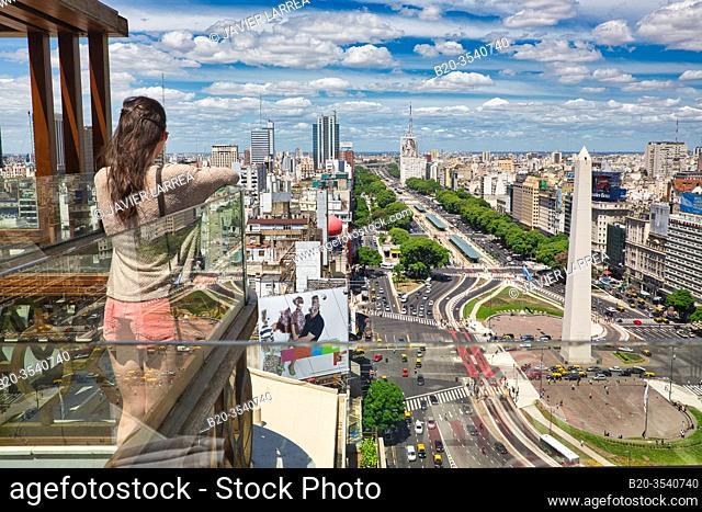 Obelisco. Avenida 9 de Julio. Buenos Aires. Argentina. View from balcony, young tourist