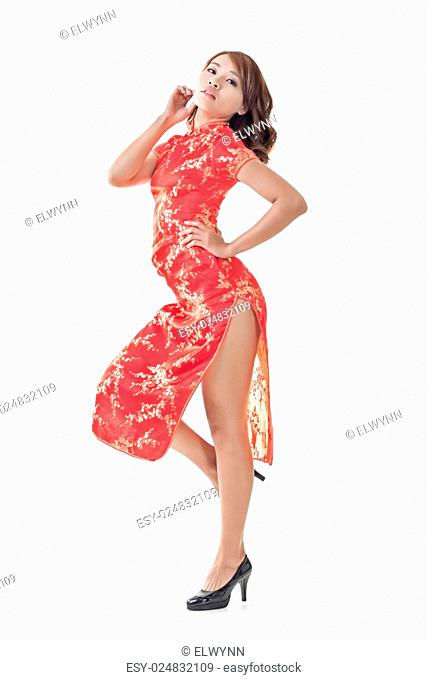 Chinese woman dress traditional cheongsam at New Year, full length portrait isolated
