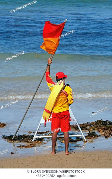 Volunteers surf lifesaver on a beach in Victoria, Australia