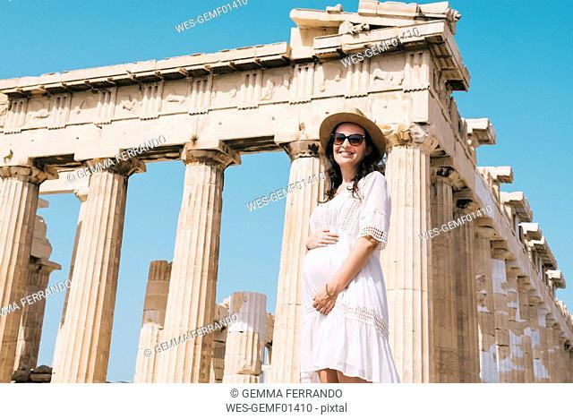 Greece, Athens, pregnant woman visiting the Parthenon temple on the Acropolis
