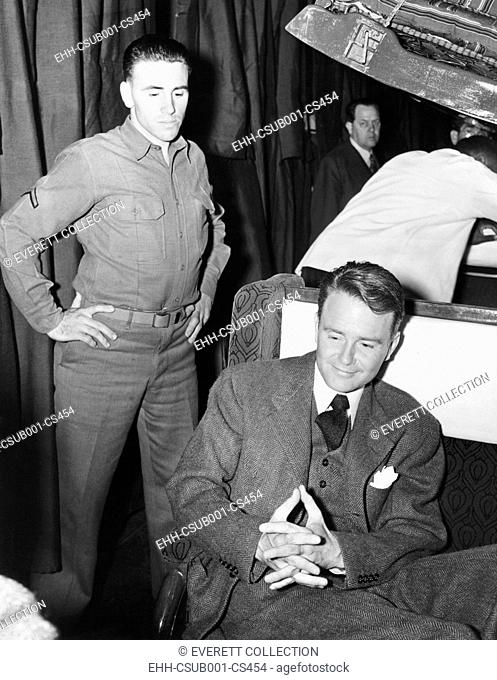 Conscientious objector, actor Lew Ayers, enroute to a labor camp at Cascade Locks Oregon. March 30, 1942. During World War II there were 152 Civilian Public...