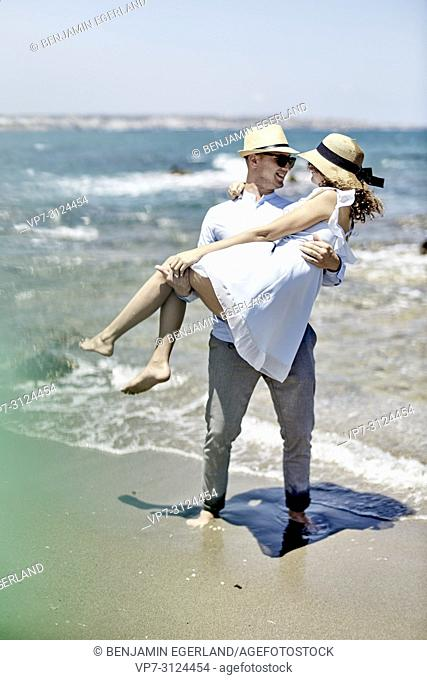 lovers, man carrying woman at beach, couple, vacations, summer, flirt