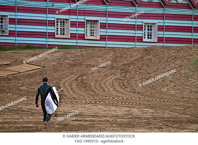 Surfer on the industrial beach of La Arena, Somorrostro, Basque country, Euskadi, Spain