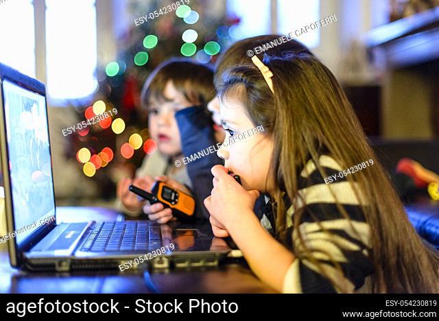 Children watch a DVD on the laptop