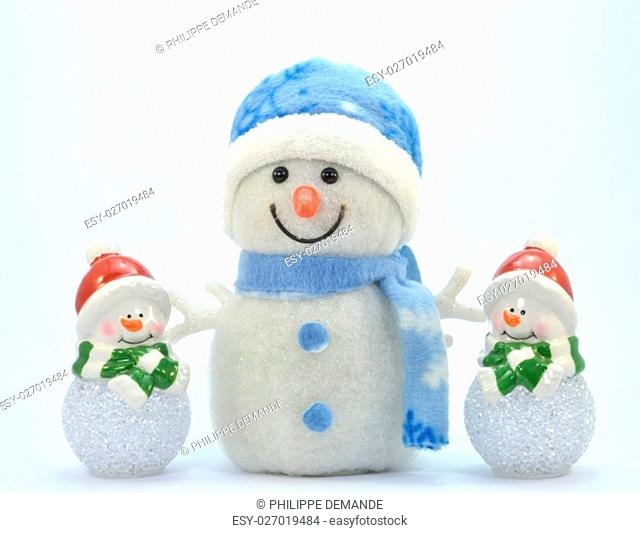 Trio of snowman with a glass ball