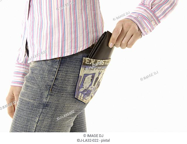 Midsection of a woman with a wallet