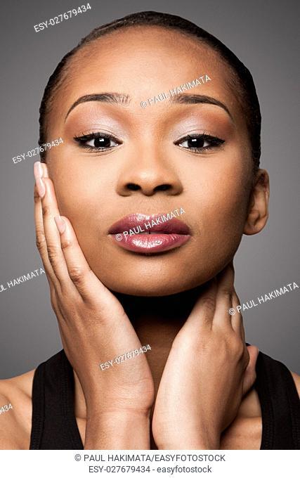 Beautiful face of black Asian blasian woman with cosmetics makeup, skincare concept