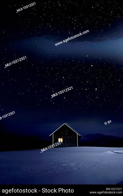Christmas-lit hut in cold winter night with a starry sky