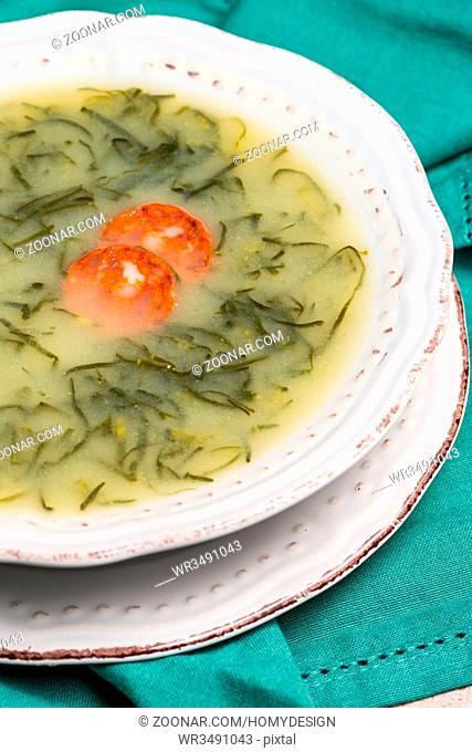 Caldo verde popular soup in Portuguese cuisine. traditional ingredients for caldo verde are potatoes, collard greens , olive oil and salt