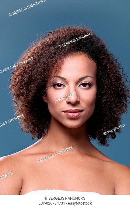 Beauty, skincare. Beautiful woman on a blue background