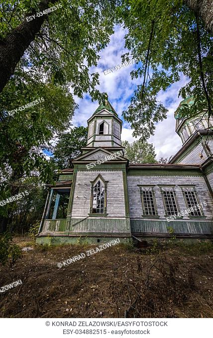 Exterior of old orthodox church of Saint Michael in Krasne, one of abandoned villages of Chernobyl Nuclear Power Plant Zone of Alienation in Ukraine