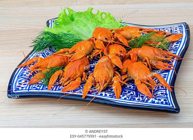 Boiled crayfish in the bowl with dill