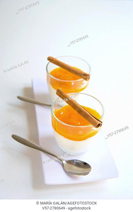 Two bowls of yoghurt with mango jam