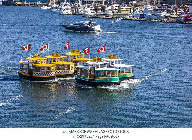 Water Taxis perfroming Water Ballet in the Inner Harbor in Victoria on Vancouver Island in British Columbia, Canada