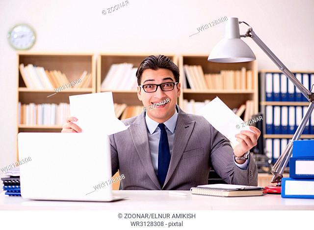 The businessman receiving letter in the office