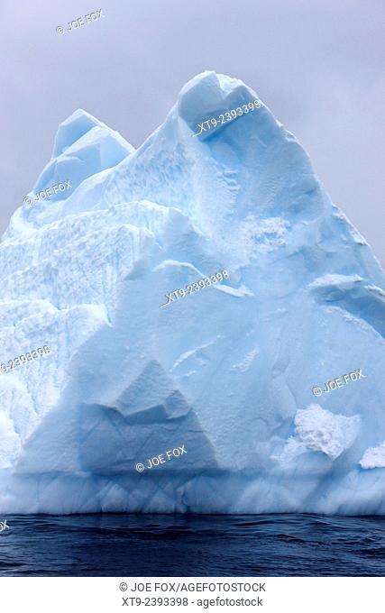 pinnacle pyramid shaped aged iceberg near cuverville island Antarctica