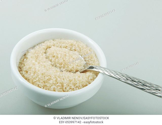 Brown sugar crystals of white background