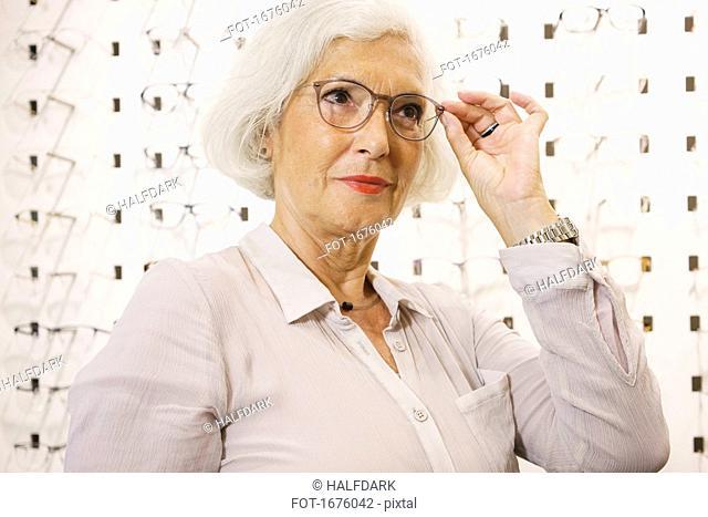 Senior woman wearing eyeglasses at store