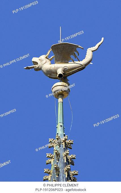 Dragon on spire of the belfry of Ghent / Gent against blue sky, East Flanders, Belgium