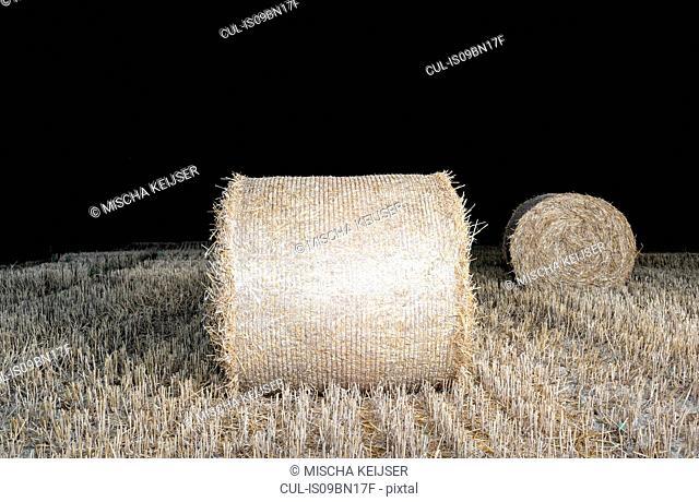 Bales of grass at night