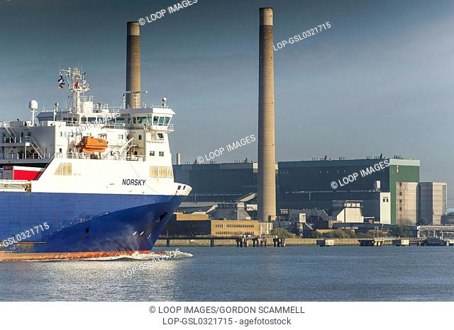 The Ro Ro cargo ship Norsky passing Tilbury B Power Station as she steams downriver on the River Thames