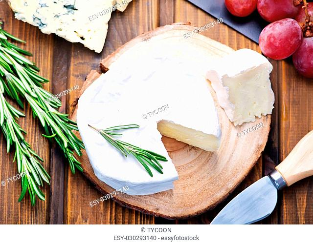 cheese on wooden board and on a table