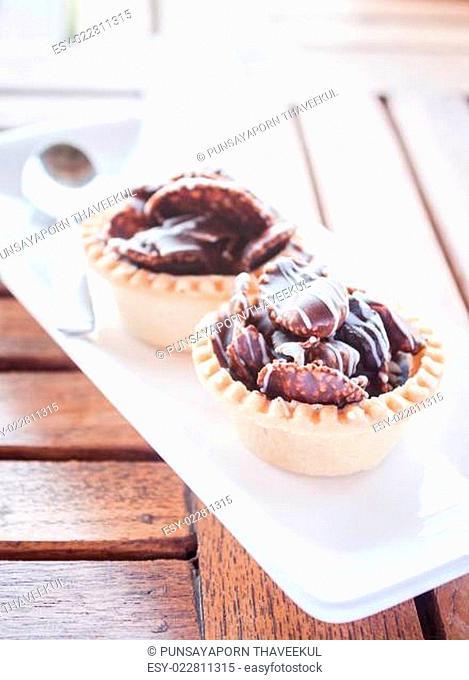 Crispy chocolate tarts on wood table