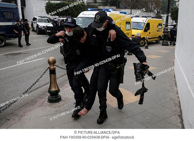 08 March 2019, Algeria, Algiers: An injured Algerian riot police man during clashes with protestors (not pictured) demonstrating against Algerian President...