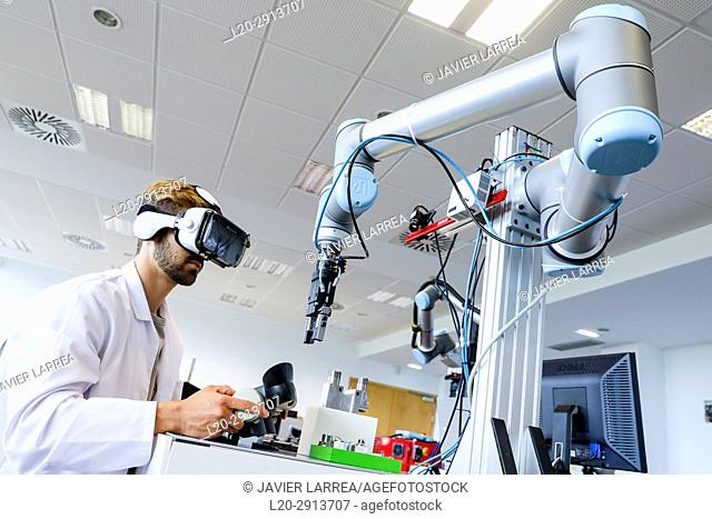 Researcher with virtual reality glasses, VR, Humanoid robot for automotive assembly tasks in collaboration with people, Industry, Tecnalia Research & innovation
