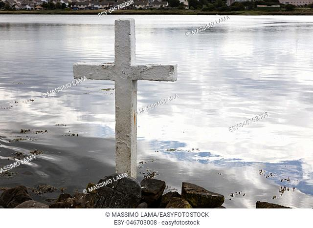 View of a lake with a white cross