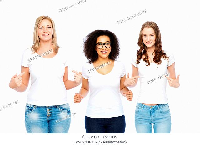 friendship, diverse, body positive and people concept - group of happy different size women in white t-shirts pointing finger to themselves