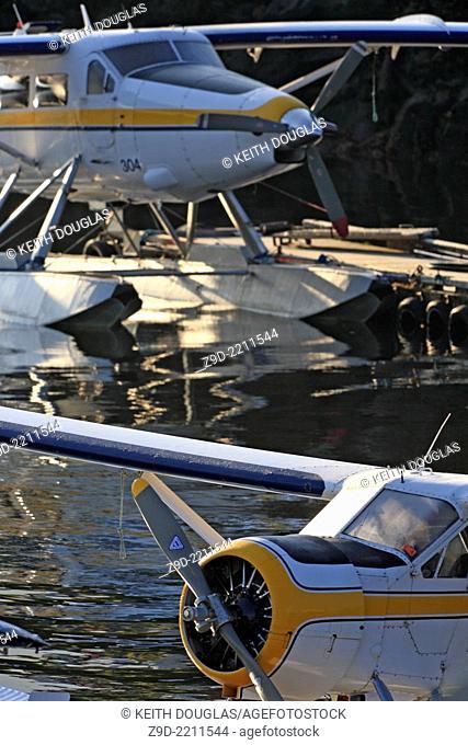 DeHavilland Otter (turbine conversion) and Beaver floatplanes tied up at dock, Seal Cove, Prince Rupert, British Columbia