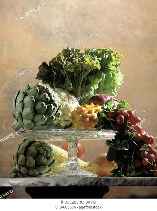 Still Life: Assorted Vegetables on a Cake Stand with a Kiwano