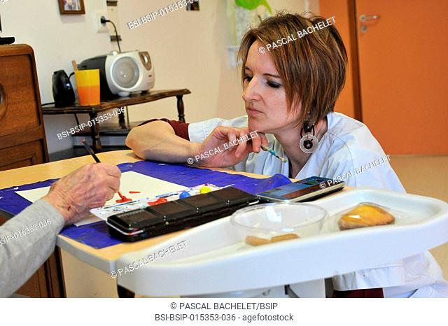 Reportage on art therapy in Ham hospital?s Alzheimer's unit, France. Art therapy sessions are offered to residents in order to maintain or rehabilitate their...