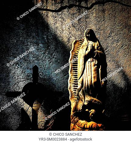 An image of Our Lady of Guadalupe decorates a tomb during Day of the Dead celebrations in Mexico City, Mexico