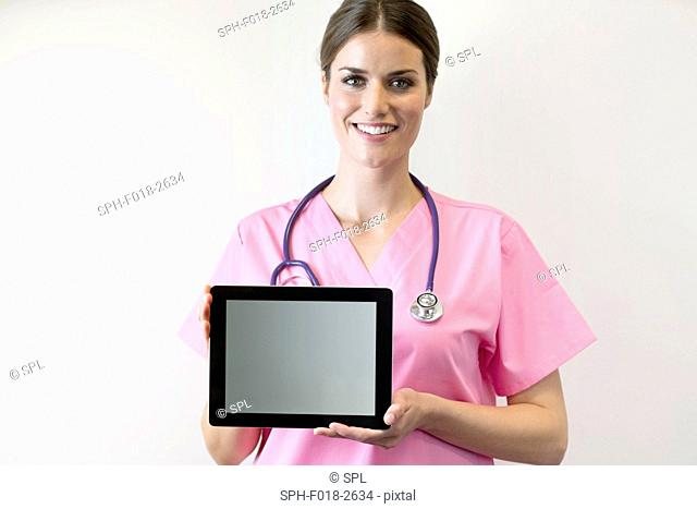 Female nurse holding digital tablet