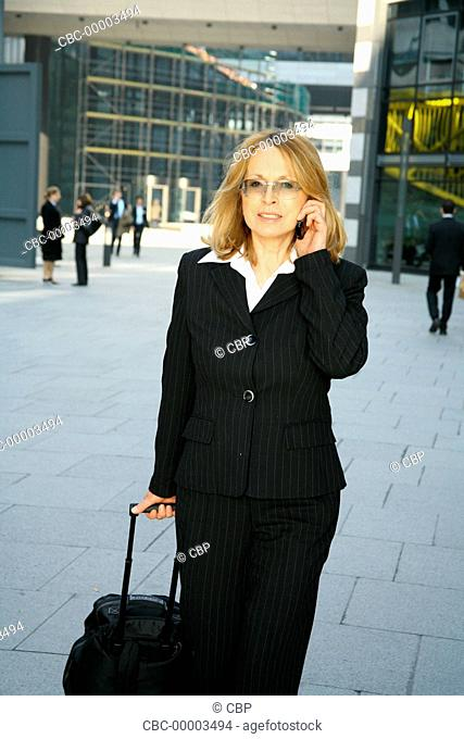 Mature Business Woman Using A Molbile Phone
