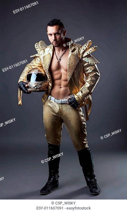Studio shot of hot muscular man in golden costume
