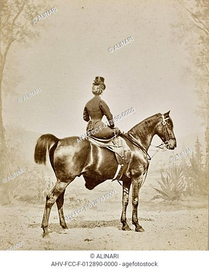 Woman on horseback photographed from behind., shot 1900 ca. by Delton, Jean (attribuited to)