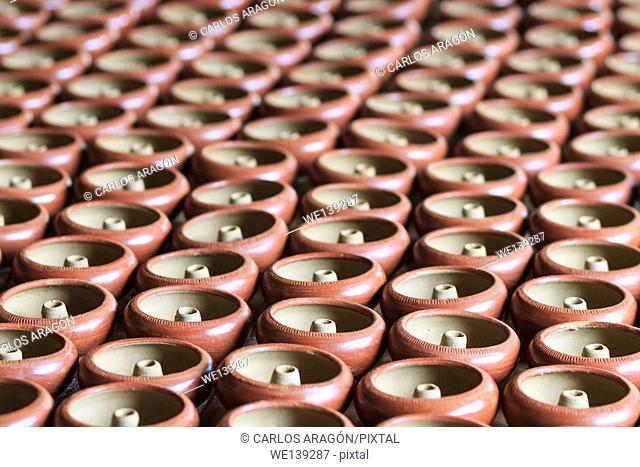 Hundreds of earthen water jars drying in the sun in Chaing Mai, Thailand