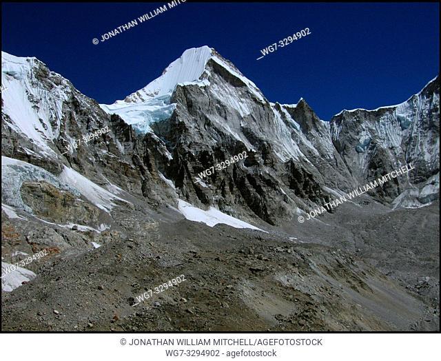 NEPAL Khumbu Glacier -- 16 Apr 2005 -- Tibetan glaciers (the ridge on this image is the border) on the slopes of Mount Lingtren (centre, 6697m)