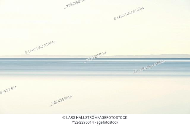 Tranquil scene of landscape in Sweden. View of lake VŠttern and sky with copy space