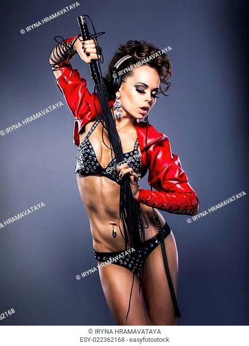 Fancy brutal brunette in erotic underwear with switch - glamour